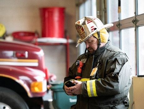 Fireman looking at smart device