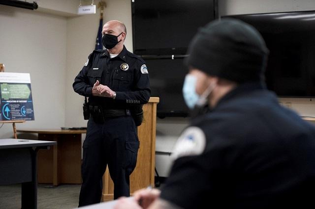 Police Officer delivering presentation