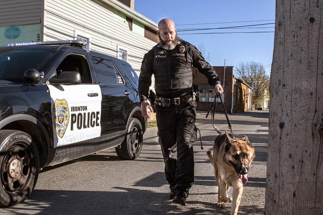 Image of police officer walking dog
