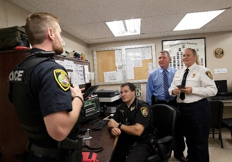 Image of group of police officers talking in an office